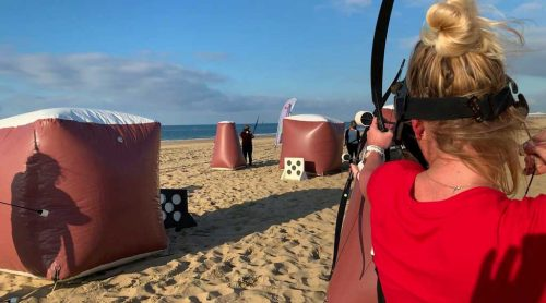 woman-shoot-with-bow-and-arrow-during-archery-tag-in-scheveningen